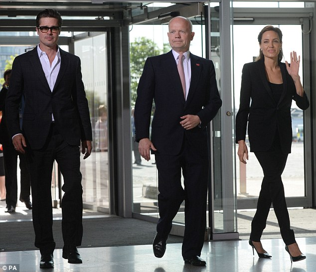 Wearing a crisp-cut suit may make you feel more powerful than you think. Not only does it change how people perceive you, but it can also alter the way you see the world.  Foreign Secretary William Hague (centre), actor Brad Pitt and actress Angelina Jolie in London last year