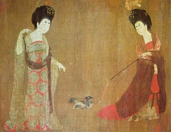 Two women playing with a lap dog, China, 8th century, Beauties Wearing Flowers by Tang Dynasty painter Zhou Fang